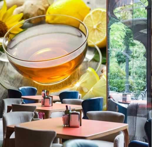 Fototapeta do herbaciarni z filiżanką herbaty imbirowej z cytryną