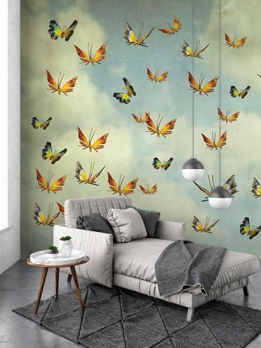 Fototapeta z motylami na tle nieba z chmurami