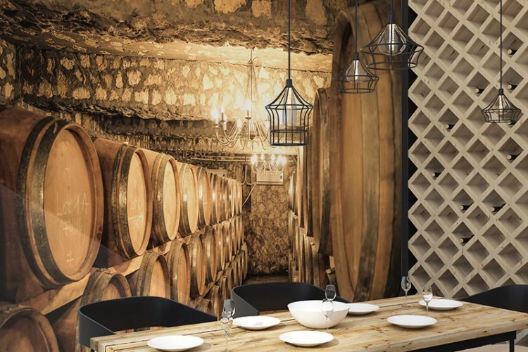 Fototapeta do winiarni z motywem beczek wina.