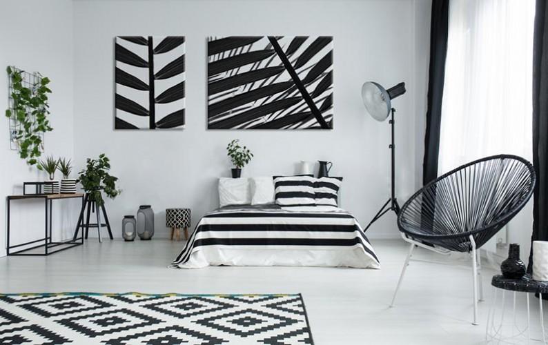 Obraz czarno-biały na płótnie z motywem liści palmy