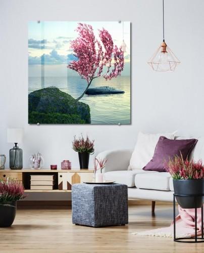 Obraz na szkle do salonu - Różowe kwitnące drzewo nad oceanem