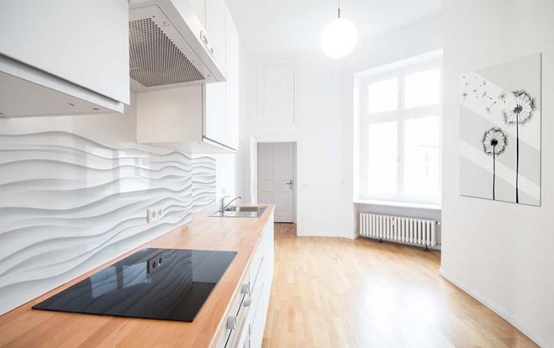 Panel szklany ze wzorem białej fali do kuchni