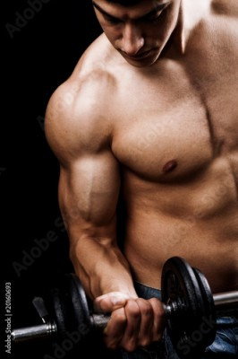 Obraz Powerful muscular man lifting weights
