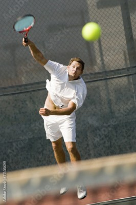 Obraz man serving tennis ball on tennis net