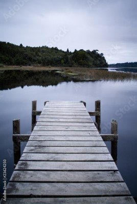 Plakat Wooden Jetty stretches out on glassy Lake Brunner in New Zealand