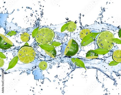 Fototapeta Fresh limes in water splash,isolated on white background