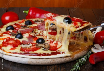 Fototapeta hot pizza with melting cheese