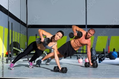 Obraz Gym man and woman push-up strength pushup