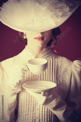 Obraz Beautiful redhead women with cup of tea