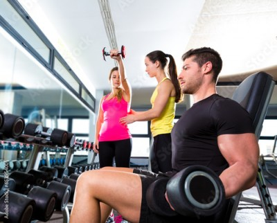 Fototapeta Dumbbell man at gym workout fitness weightlifting