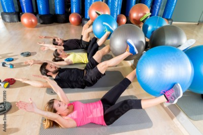 Fototapeta Fitball crunch training group core fitness at gym