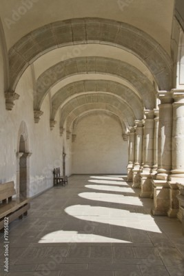 Fototapeta passage with arches and columns