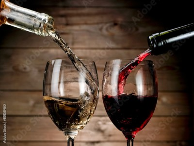 Obraz Red and white wine pouring on wood background