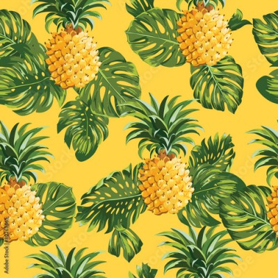 Fototapeta Pinapples and Tropical Leaves Background