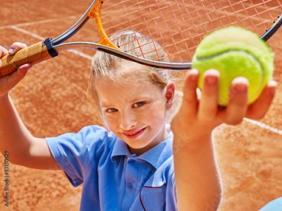 Obraz Child with racket and ball on tennis court