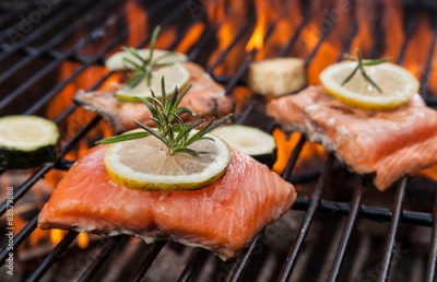 Fototapeta Grilled salmon steaks on fire
