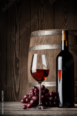 Obraz Glass of red wine with bottle and keg standing