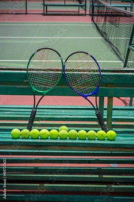 Obraz tennis racket and balls on the tennis court