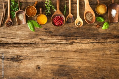 Fototapeta Colorful spices on wooden table