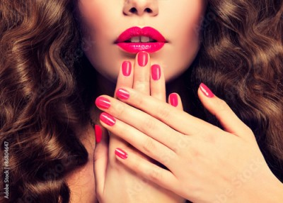 Obraz Beautiful girl showing crimson manicure