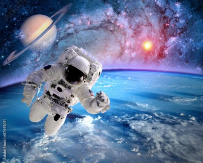 Fototapeta Astronaut spaceman outer space planet saturn earth sun universe. Elements of this image furnished by NASA.