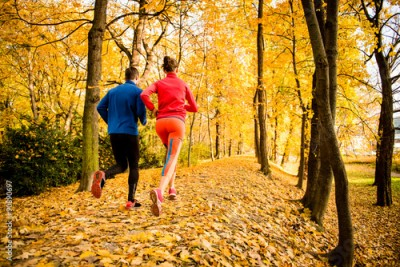 Fototapeta Couple jogging in autumn nature