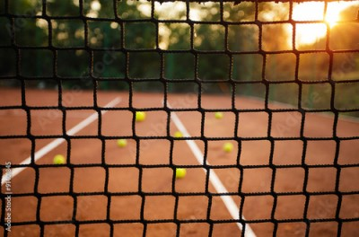 Obraz Close up of tennis net with balls in background