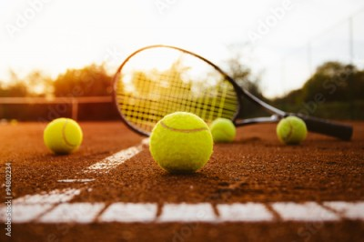 Obraz Tennis balls with racket on clay court