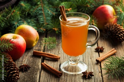 Obraz Hot apple cider traditional winter season drink with cinnamon and anise. Homemade healthy organic warm spice beverage. Christmas or thanksgiving holiday decoration on vintage wooden background