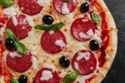 Fototapeta pizza with salami tomato and cheese