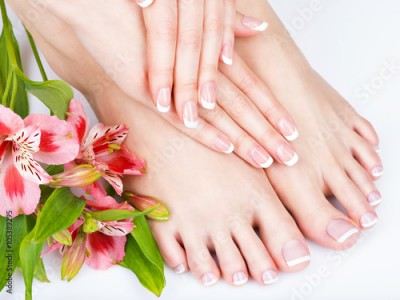 Obraz female feet at spa salon on pedicure and manicure procedure
