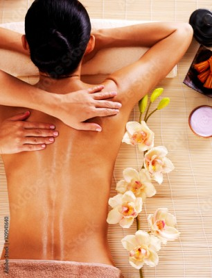 Obraz Adult woman in spa salon having body massage.