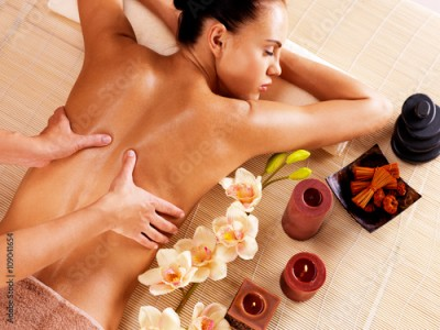 Obraz Masseur doing massage on woman back in spa salon