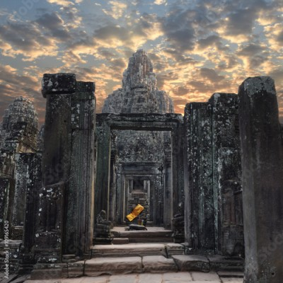 Obraz Angkor Wat, Siem Reap, Cambodia - Stone head on towers of Bayon temple with Buddha statue at the entrance