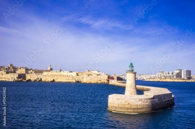 Obraz na płótnie Valletta, Malta - old Lighthouse and Breakwater bridge in the morning with blue sky