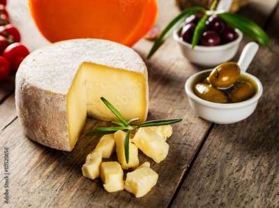 Obraz Traditional italian cheese placed on wood