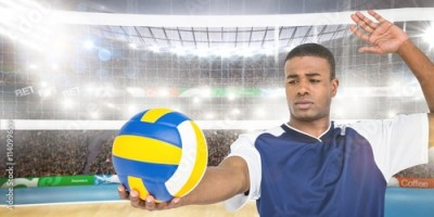 Obraz na płótnie Composite image of sportsman playing a volleyball