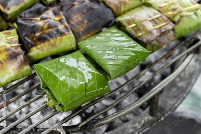 Fototapeta Closeup Fish in banana leaf on the grill, Thai style food