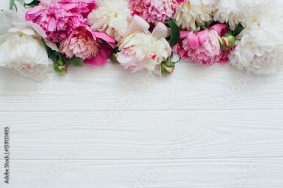 Obraz na Szkle White and pink peonies on a wooden background.