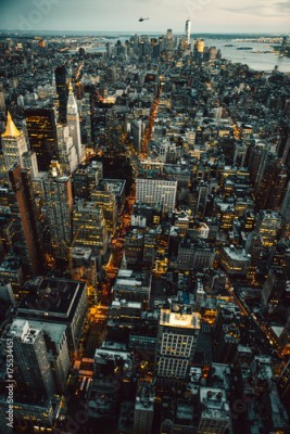 Fototapeta Manhattan New York City buildings lights aerial top view at the night time