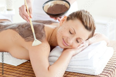 Obraz Relaxed woman enjoying a mud skin treatment