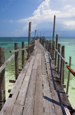 Fototapeta Wooden jetty in tropical waters.