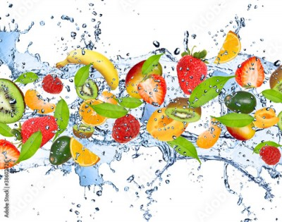 Fototapeta Fresh fruits in water splash, isolated on white background