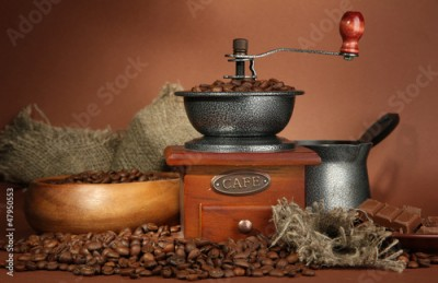 Obraz na Szkle Coffee grinder, turk and coffee beans on brown background