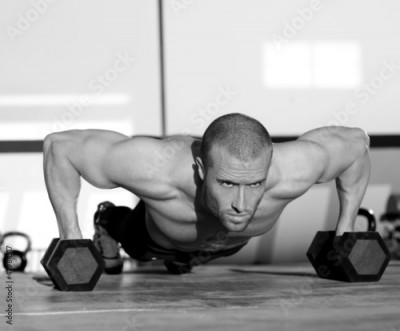 Obraz Gym man push-up strength pushup with dumbbell