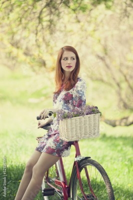 Obraz Girl on a bike in the countryside