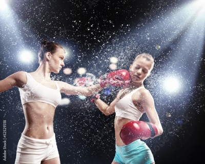 Fototapeta Two pretty women boxing