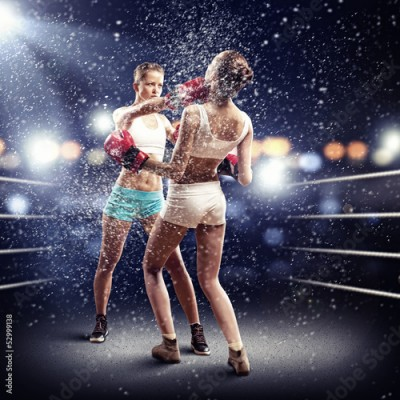Fototapeta Two women boxing in ring