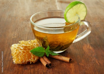 Obraz Transparent cup of green tea with honey and cinnamon