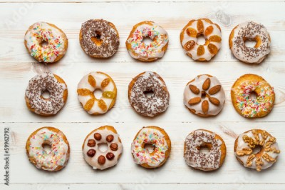 Fototapeta Group of colorfully decorated donuts